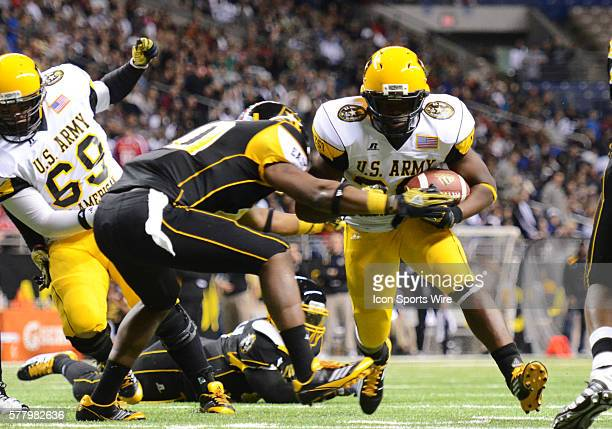 US Army AllAmerican West Team RB Malcolm Brown is tackled during the 2011 US Army AllAmerican Bowl Football Game in the Alamo Dome in San Antonio Tx