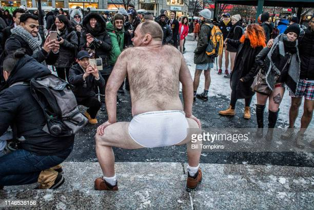 January 8, 2017]: Man squats in front of crowd wearing only his white underwear during the NO PANTS SUBWAY RIDE day in Union Square Park on January...