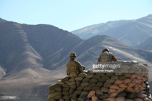 january 9, 2011 - u.s. army soldiers run communications equipment from a sandbag bunker in the daymirdad district center, wardak province, afghanistan. - sandbag stock pictures, royalty-free photos & images