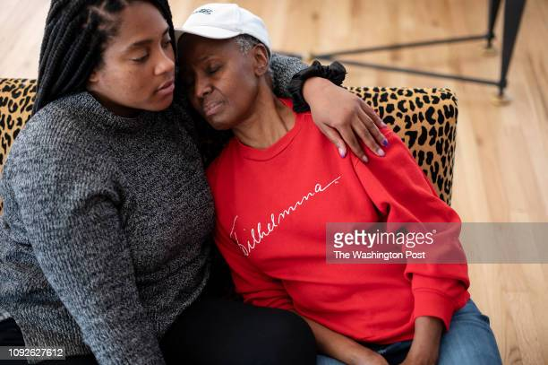 B Smith naps on her daughter Dana Gasby's shoulder as they sit together on a couch in their East Hampton home on Long Island New York on Wednesday...
