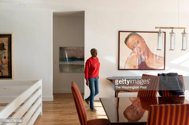 B Smith passes a portrait of herself by the artist Sid Daniels as she walks in her East Hampton home on Long Island New York on Wednesday January 9...