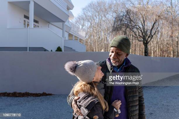 Dan Gasby right and Alex Lerner embrace as they leave their East Hampton home on Long Island New York on Wednesday January 9 2019 Early onset...
