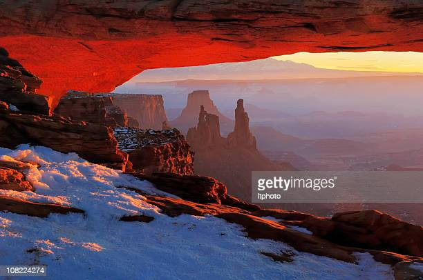 january sunrise at mesa arch - sandstone stock photos and pictures