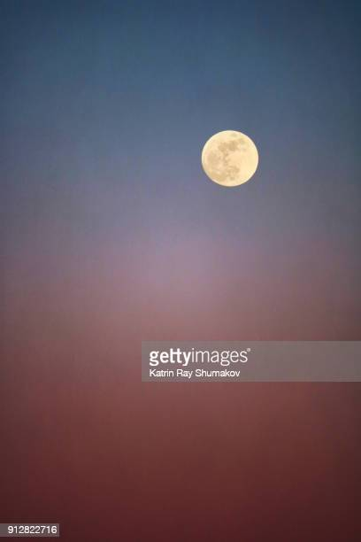 January Super Blue Blood Moon Rising at Sunset
