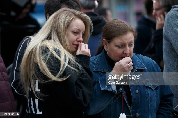 January Wood and her mother Susan Wood react as they take in the memorial for victims of the mass killing on Yonge Street at Finch Avenue on April 24...