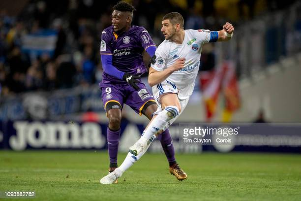Stefan Mitrovic of Strasbourg challenged by Yaya Sanogo of Toulouse during the Toulouse FC V Strasbourg Ligue 1 France regular season match at...