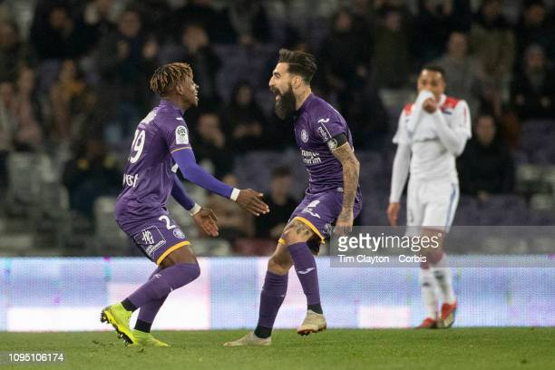 January16: Jimmy Durmaz of Toulouse celebrates with team mate Francois Moubandje of Toulouse after scoring an early goal during the Toulouse FC V...
