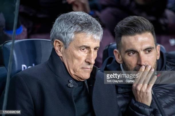 Quique Setien head coach of Barcelona and assistant coach Eder Sarabia in the dugout before the start of the Barcelona V Granada La Liga regular...