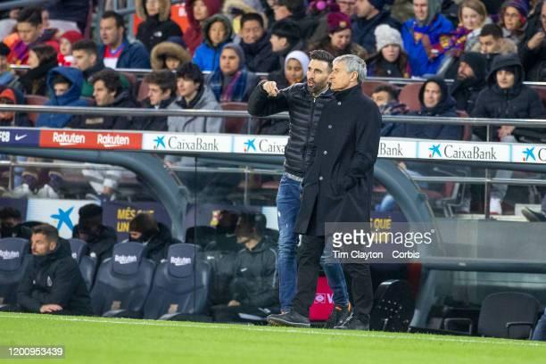 Quique Setien head coach of Barcelona and assistant coach Eder Sarabia on the sideline during the Barcelona V Granada La Liga regular season match at...