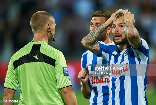 Janus Drachmann and Sander Svendsen of OB Odense showing frustration against the linesman after the Danish 3F Superliga match between OB Odense and...