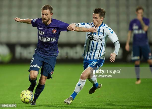 Janus Drachmann of FC Midtjylland and Jens Jakob Thomasen of OB Odense compete for the ball during the Danish Cup DBU Pokalen match between OB Odense...