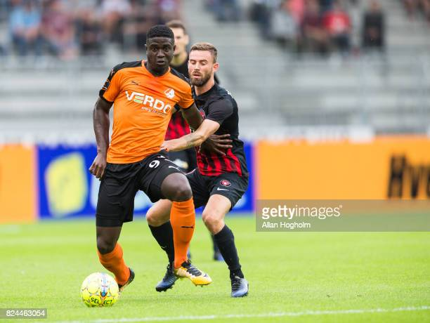 Janus Drachmann of FC Midtjylland and Mayron George of Randers FC compete for the ball during the Danish Alka Superliga match between FC Midtjylland...