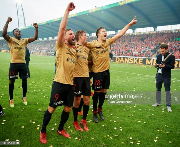 Janus Drachmann of FC Midtjylland Jakob Poulsen of FC Midtjylland and Erik Sviatchenko of FC Midtjylland celebrating the Danish Championship after...