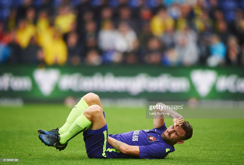 Janus Drachmann of FC Midtjylland lying g injured on the pitch during the Danish Alka Superliga match between Brondby IF and FC Midtjylland at Brondby Stadion on July 16, 2017 in Brondby, Denmark.