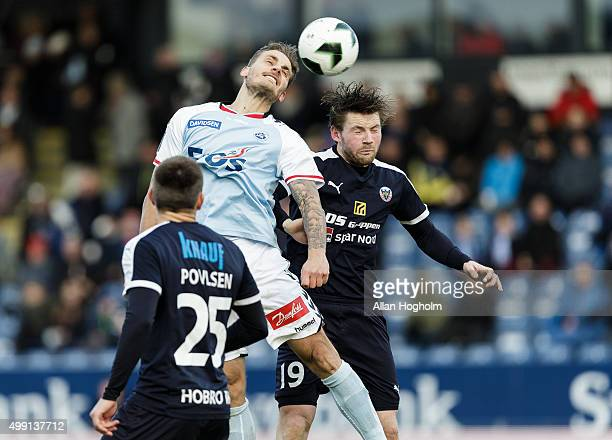 Janus Drachmann of SonderjyskE and Pal Alexander Kirkevold of Hobro IK compete for the ball during the Danish Alka Superliga match between...
