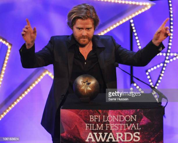 Janus Metz receives the Grierson Award for best documentary for 'Armadillo' during the ceremony for the 54th BFI London Film Festival Awards at LSO...
