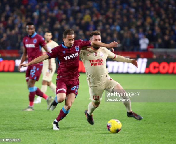 Jao Pereira of Trabzonspor in action against Omer Bayram of Galatasaray during the Turkish Super Lig week 13 soccer match between Trabzonspor and...