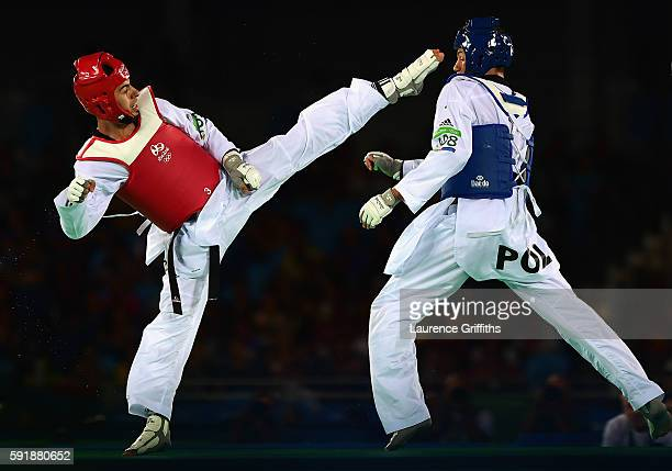 Jaouad Achab of Belgium competes against Karol Robak of Poland during the Mens 68kg Taekwondo quarter final contest at Cairoca Arena 3 on August 18...