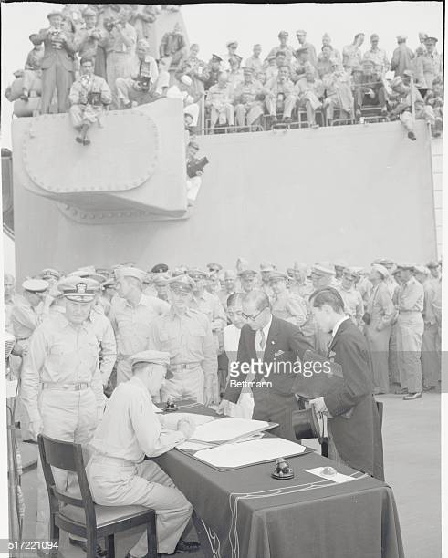 Jap Surrender Signing Photo by Bob Bryant INP staff cameraman with wartime still picture pool General view of finale of Japanese surrender aboard USS...