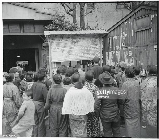 Jap Voters Check Candidates Tokyo Japan Gathered outside the Aoyagi Primary School are prospective voters who study a bulletin board which lists all...