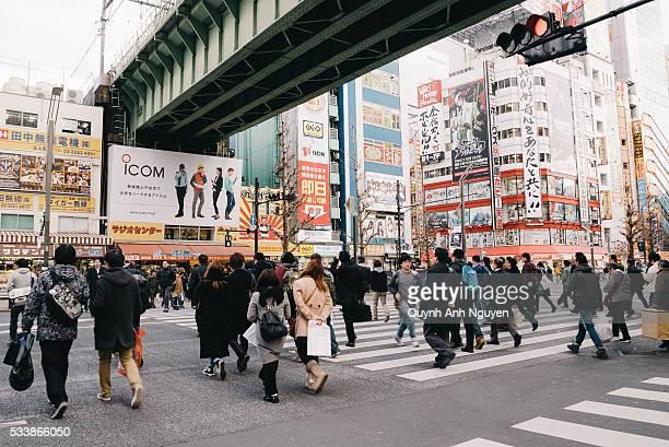 japan - a crosswalk at akihabara area in tokyo - akihabara stock pictures, royalty-free photos & images