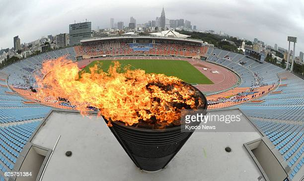Japan - A flame is lit in the 1964 Tokyo Olympics cauldron in celebration at the National Olympic Stadium in Tokyo on Sept. 8 after the Japanese...
