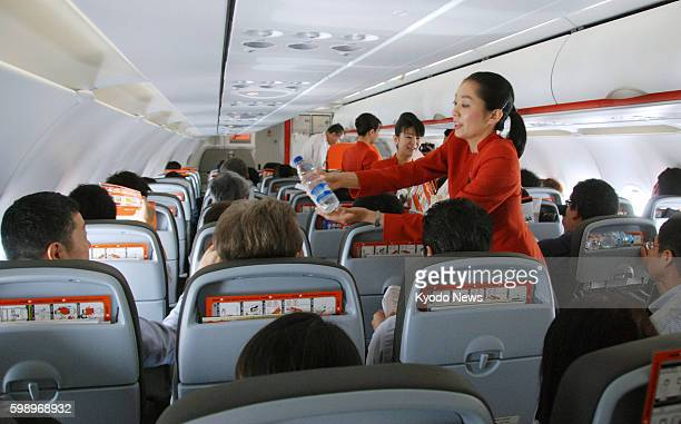 NARITA Japan A flight attendant sells goods on the first flight of Jetstar Japan Co en route to Sapporo from Narita near Tokyo on July 3 2012 The...