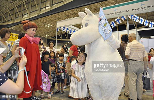 YOKOHAMA Japan A girl and animation character Moomin pose for a photo as the Japan World Stamp Exhibition 2011 began in Yokohama on July 28 2011 The...
