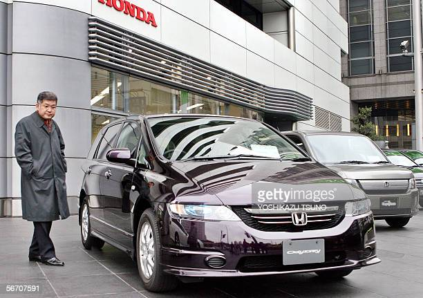 A Japanese customer checks Japanese auto giant Honda Motor's minivan Odyssey at the compnay's headquaters in Tokyo 31 January 2006 Honda said its...