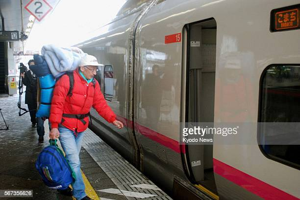 AKITA Japan A man boards a car of the Akita Shinkansen Line at JR Akita Station in Akita Prefecture on March 18 after the bullet train line resumed...