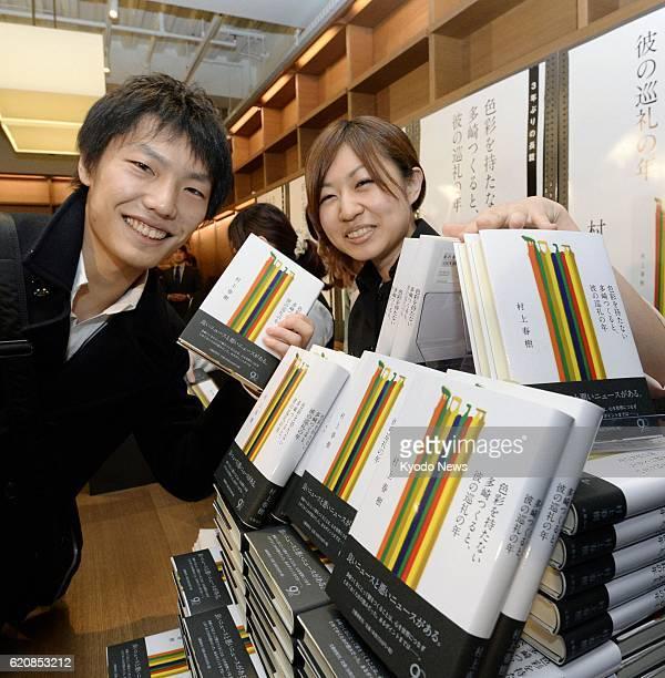 TOKYO Japan A man holds an issue of the new novel by acclaimed Japanese author Haruki Murakami titled 'Shikisaiwo motanai Tazaki Tsukuruto kareno...