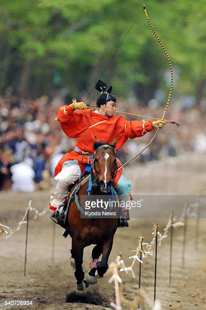 KYOTO Japan A man shoots an arrow while riding a horse in traditional attire in the annual ''yabusame'' ritual held at Shimogamo Jinja shrine in...