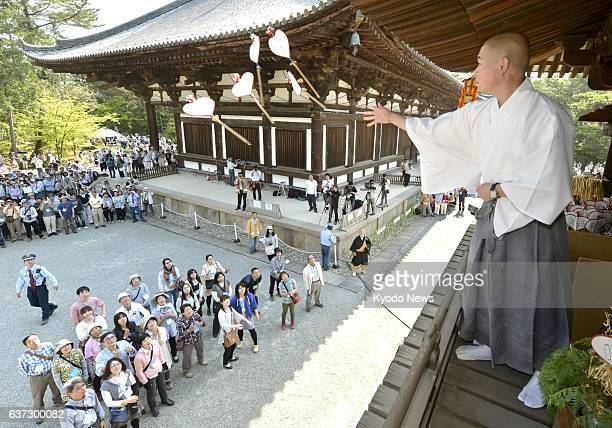 NARA Japan A monk throws heartshaped paper fans believed to drive away evil spirits from the drum tower of Toshodaiji Temple in Nara toward people in...
