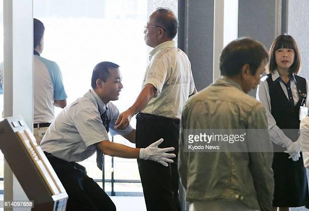 NARITA Japan A passenger undergoes a random patdown at Narita airport near Tokyo on Oct 1 as the transport ministry the same day instituted random...