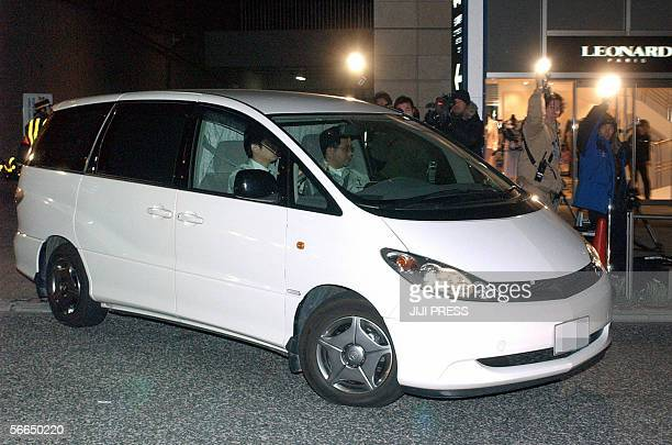 A police van carrying Takafumi Horie President of Japan's internet firm Livedoor leaves the company headquarters to Tokyo prosecutors office in a...