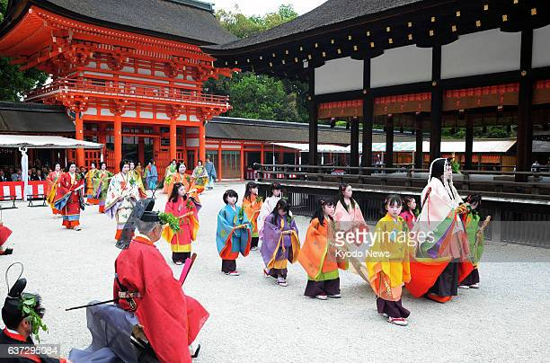 KYOTO Japan A procession of people dressed as nobles in ancient courtstyle attire from the Heian era goes through the Shimogamo Shrine on May 15...