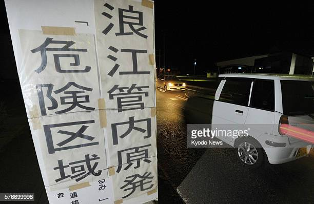KAWAMATA Japan A sign on a road in Kawamata Fukushima Prefecture says ''danger zone'' to caution vehicles against entering an area within a...