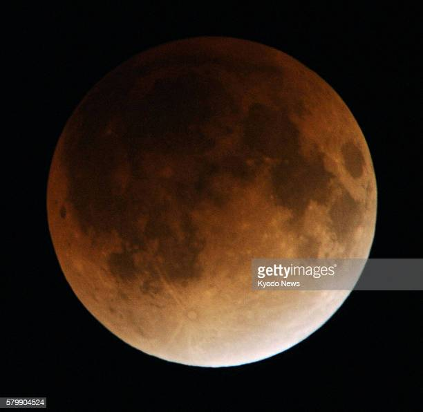 TOKYO Japan A total lunar eclipse is observed in Tokyo's Higashishimbashi area at 1110 pm on Dec 10 2011