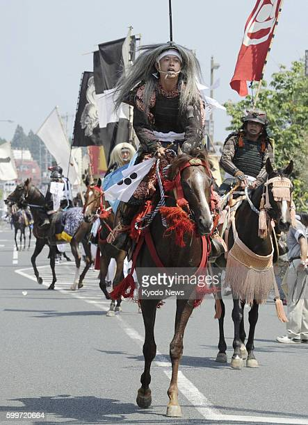 SOMA Japan A warrior procession marches on a street in Soma Fukushima Prefecture on July 28 in a wild horse chase festival The threeday Soma Nomaoi a...
