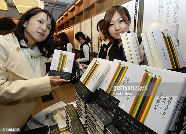 TOKYO Japan A woman holds an issue of the new novel by acclaimed Japanese author Haruki Murakami titled 'Shikisaiwo motanai Tazaki Tsukuruto kareno...