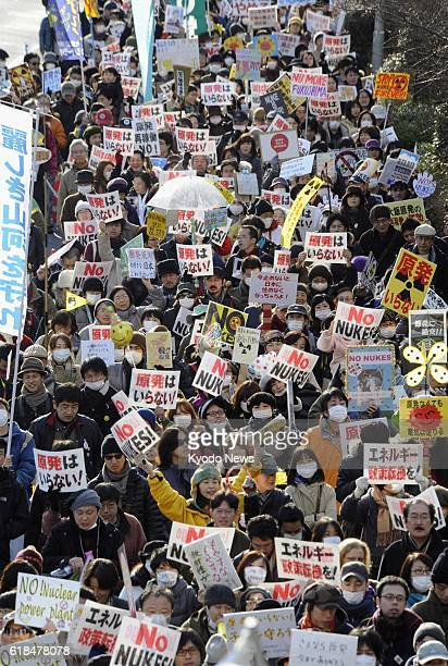 TOKYO Japan About 12000 people demonstrate in Tokyo's Shibuya Ward after a rally calling for abandoning nuclear power on Feb 11 2012