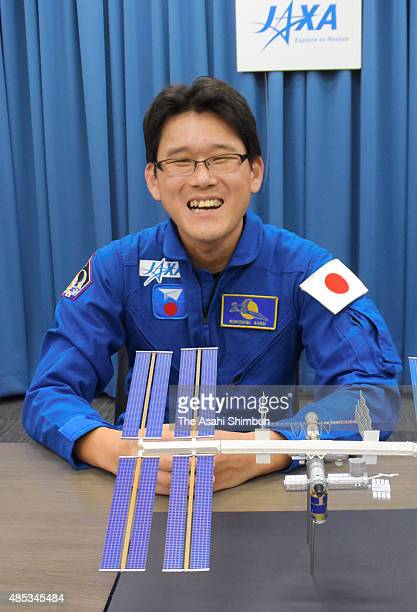 Japan Aerospace Exploration Agency astronaut Norishige Kanai smiles during a press conference at the JAXA Tokyo office on August 27 2015 in Tokyo...