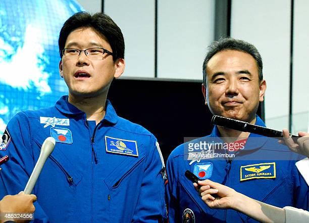 Japan Aerospace Exploration Agency astronaut Norishige Kanai speaks to media reporters while astronaut Satoshi Furukawa listens at the Miraikan the...