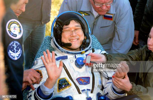Japan Aerospace Exploration Agency astronaut Norishige Kanai waves after getting out from the Soyuz MS07 spacecraft on June 3 2018 in Zhezkazgan...
