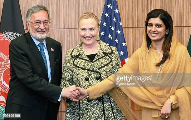 TOKYO Japan Afghan Foreign Minister Zalmai Rassoul US Secretary of State Hillary Clinton and Pakistani Foreign Minister Hina Rabbani Khar shake hands...