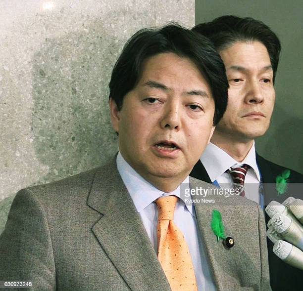 TOKYO Japan Agriculture Forestry and Fisheries Minister Yoshimasa Hayashi answers reporters' questions at the ministry in Tokyo on April 18 2014 The...