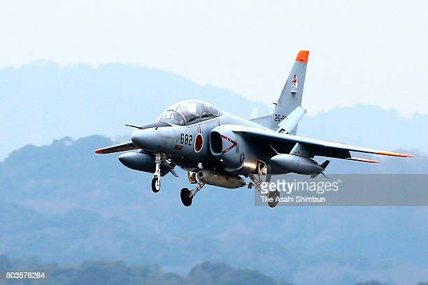 A Japan Air SelfDefense Force T4 training aircraft lands after collecting radioactive substance possibly spread in the air after North Korea's...
