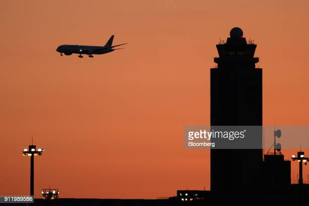 A Japan Airlines Co aircraft approaches to land at Narita Airport in Narita Chiba Prefecture Japan on Sunday Jan 28 2018 JAL is scheduled to release...