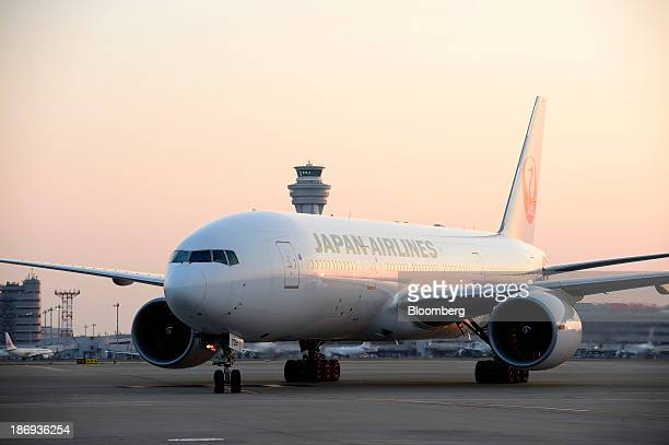 A Japan Airlines Co aircraft carrying the first shipment of Beaujolais Nouveau wine taxies after landing at Haneda Airport in Tokyo Japan on Tuesday...