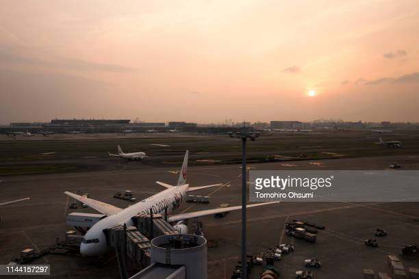 Japan Airlines Co aircraft is parked at Haneda Airport at dusk ahead of Golden Week on April 21 2019 in Tokyo Japan Japanese people will enjoy a rare...